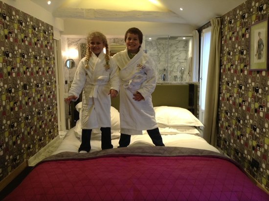 Artus Hotel by MH : kids robes and slippers on parents bed!!