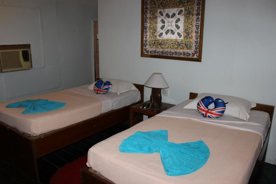 Sukau River Lodge: Our bed room - the Aussie travel pillows were ours!