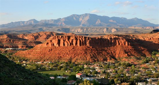 The INN at St.George: A view of downtown St. George with Red Rock Cliffs and Pine Mountain in background.