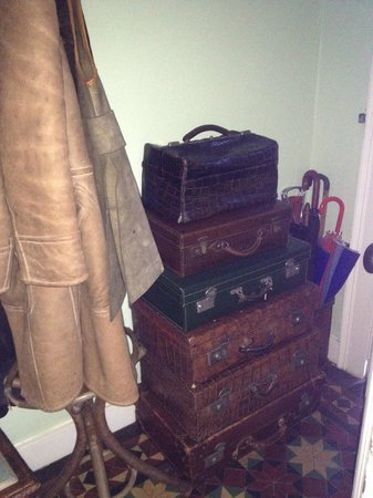 Ingrams: Old suitcases in the hallway in the nicely decorated 19th century home