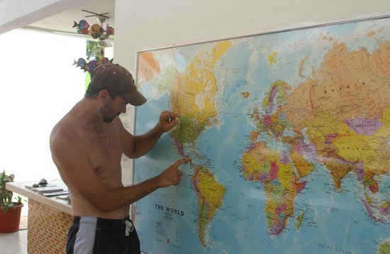 The Amazing Hostel Sayulita: CEO Scott Woodhams of Central America Overland Expeditions points to a map