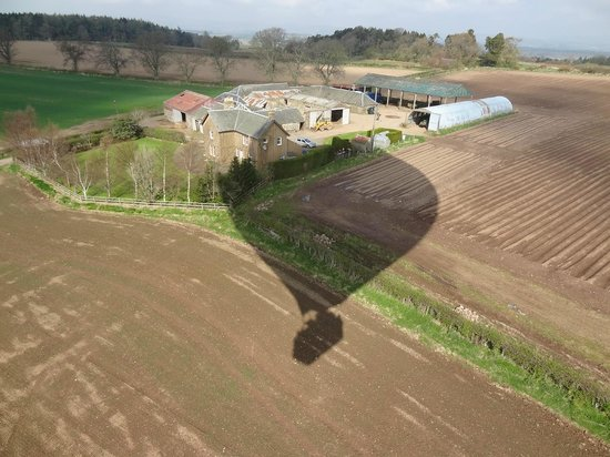 Virgin Balloon Flights: Shadow of balloon over farm.