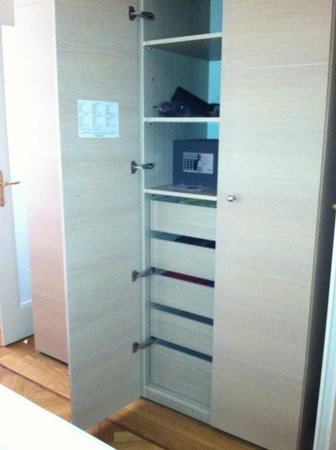 Residence Karolina - Prague City Apartments : Half of the built-in -- the other side had a clothes rod and wooden hangers, plus several shelve