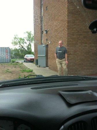 Days Inn Syracuse University: Barefoot guy hanging outside open security door