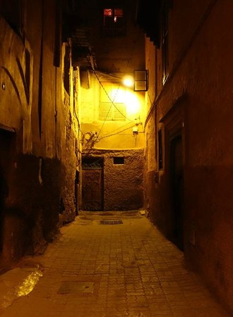 Riad Dar One: The last alleyway at night.  The riad's door is at the end of the wall at left