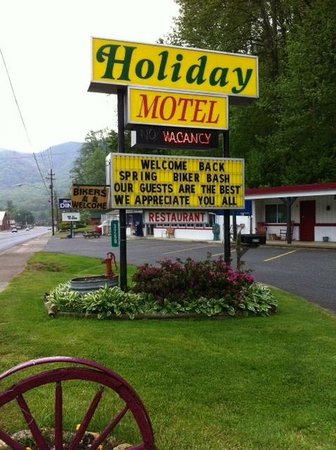 A Holiday Motel: Our Street sign