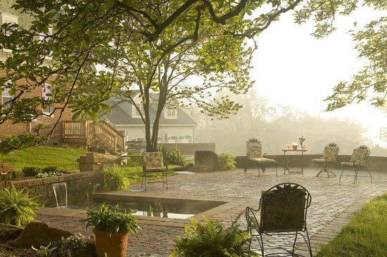 The Carriage House Inn Bed and Breakfast: Relax on our patio with fish pond