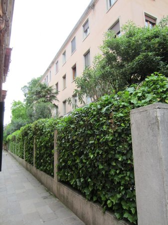 Hotel Santa Lucia: Alley/street behind the hotel.  Our outside patio opened to the other side of this fence