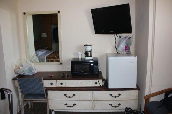 Sunbeam Motel: Room #6 Dresser drawers, mini-fridge, TV, microwave, coffee pot
