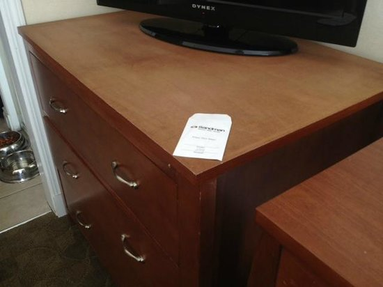 Sandman Hotel & Suites Calgary West: stripped tv stand surface?