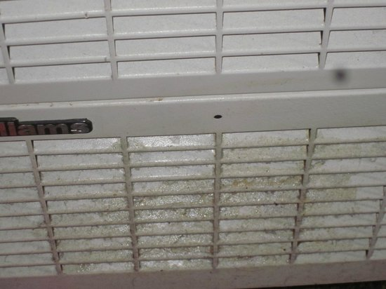 Inn at Calafia Beach : this is build up dust and grease on the furnace vent...again very unsanitary