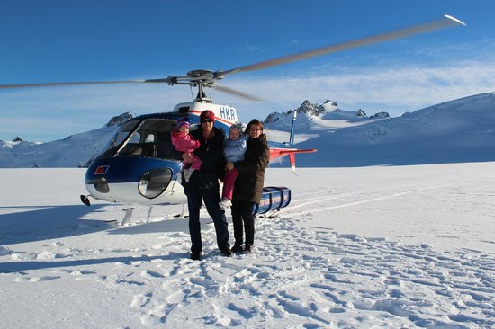 The Helicopter Line West Coast: Our family in with the helicopter behind us - glorious snow capped peaks around us