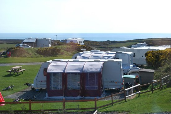 Blackthorn Farm: View to the sea with the camping ground in the foreground.