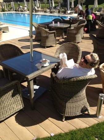Pennyhill Park, an Exclusive Hotel & Spa: Sunning ourselves in the pool area -- pure bliss!