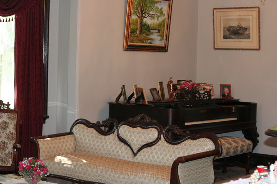 The Dominion House: Piano in the parlor