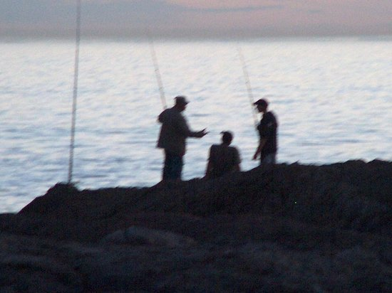 Bloubergstrand, South Africa: Line fishing from the rocks at Blouberg