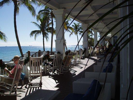 Pelican Grand Beach Resort, A Noble House Resort: Veranda for relaxing