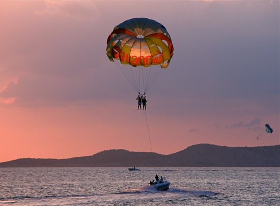 Parasending over the bay at Cafe Del Mar