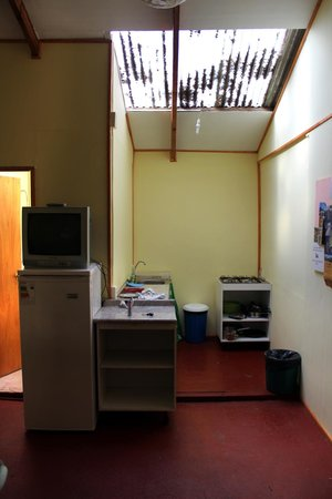 Fatima's Hostel: The kitchen is strait ahead and one of the two bathrooms is through the door beside the TV.