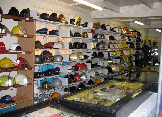 Manston, UK: A small selection of Fire service hats & helmets from around the worl