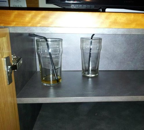 Esplanade Hotel Fremantle - by Rydges: dirty glasses under tv cabinet