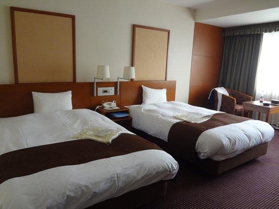 Meitetsu Grand Hotel : Kamar hotel dengan twin bed
