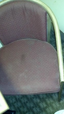 Red Roof Inn Michigan City: Gross stained chairs in 2 of the rooms, caked with dust.