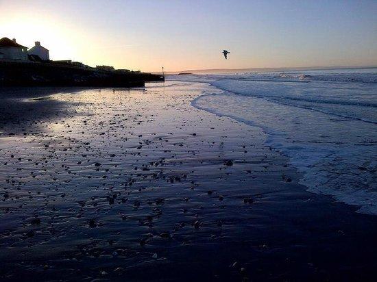 Tywyn Beach: Sun rise towards the town.