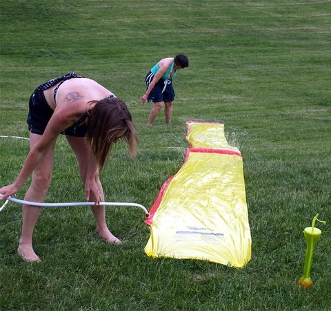 Normandy Farms Family Camping Resort: Setting up a slip n slide can be hard work!