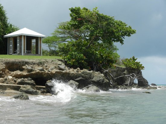 Montpelier Plantation & Beach: the end of the private beach with a cabana on a small bluff