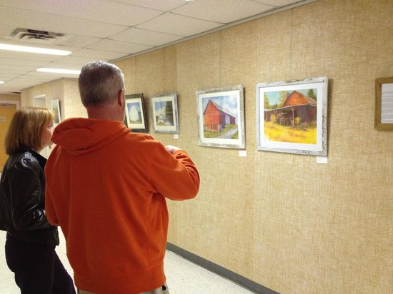 Shenandoah Showcase - Art at the Strasburg Town Hall: Steve Witt enjoys the art.