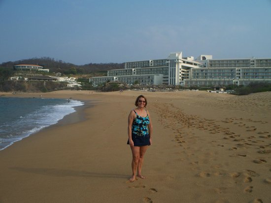 Secrets Huatulco Resort & Spa: my wife on beach with hotel in background