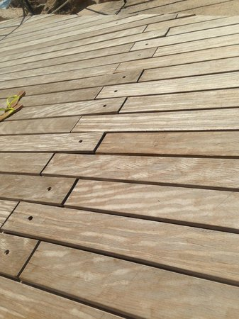 Capo La Gala Hotel: Dear hotel owner.. removing these bolts has turned your deck into a drum kit!  not relaxing!
