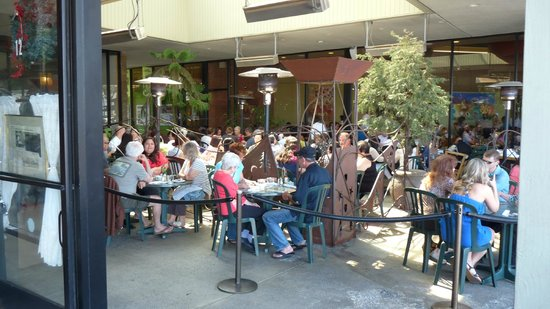 Plums Cafe: The added patio seating left us with the view of a store front for rent