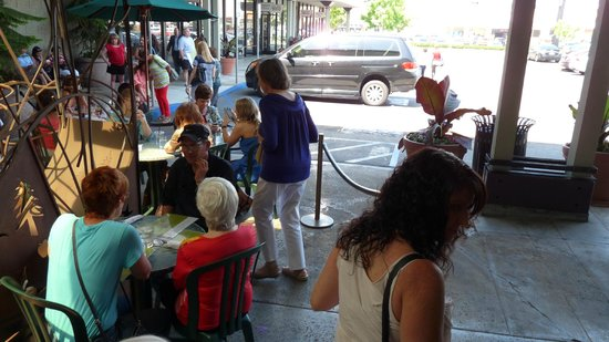 Plums Cafe: The crowd control ropes do not make booze legal for every customer sitting out there with a drin