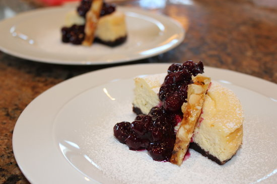 Blanket and Spoon : NY style cheesecake blueberry compote and macadamia praline