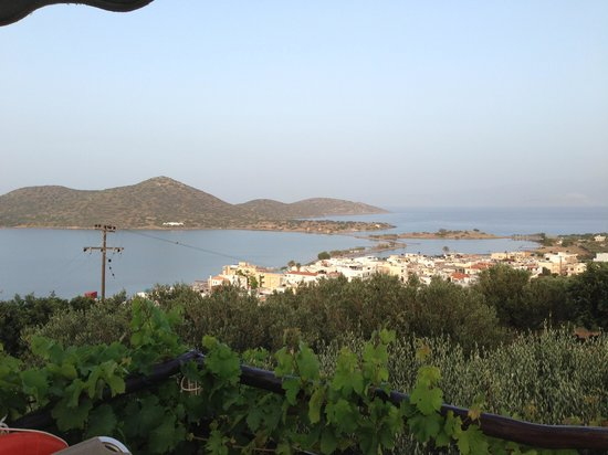 Elounda Heights Apartments and Studios: View at sundown from the pool