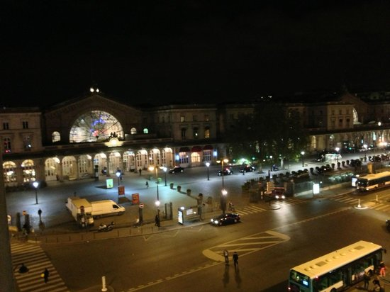 Modern' Est: View of Gare de l'Est at night from our 5th floor room