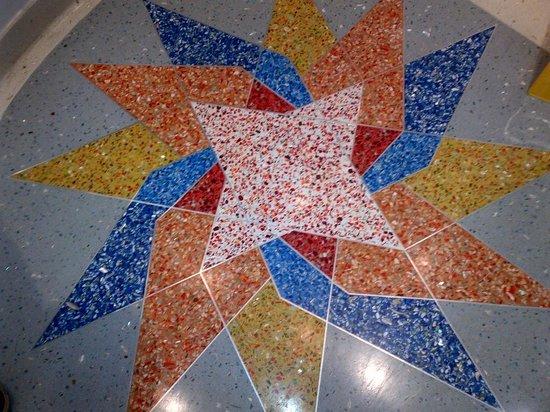 Nesva Hotel : Lobby floor tile mosaic.