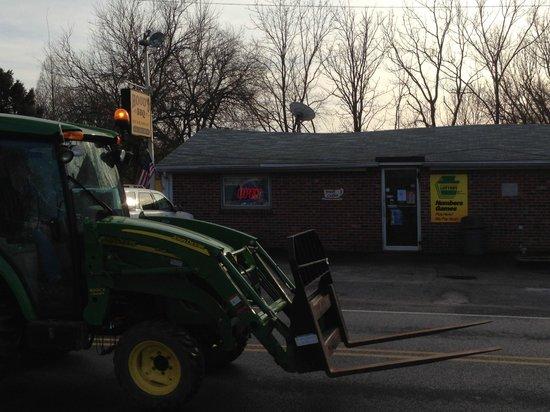Hood's BBQ & Deli: Tractor on Doe Run Road passing Hood's Barbeque
