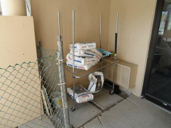 CJS Inn: Building materials outside back Reception door
