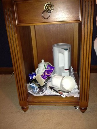 The Old Priory: tea & coffee thrown into bottom of bedside cabinet with door missing