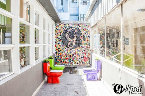 The G Spot Hostel: Outdoor area complete with Mural