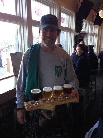 New Belgium Ranger Station Restaurant : Brad delivering a beer sampler