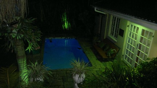 Acorn B&B in Durban: Look of my room by pool side at night from dinning area