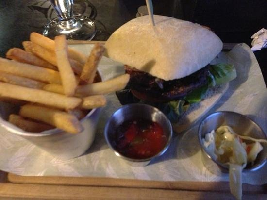 Village Hotel Coventry: The extremely greasy burger with a fork full of coleslaw