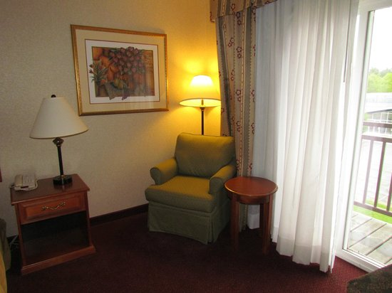 Holiday Inn Express & Suites White River Junction : Comfortable chair near the sliding glass door.