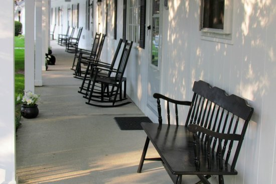1896 House - Brookside & Pondside Motels: Chairs outside the rooms.