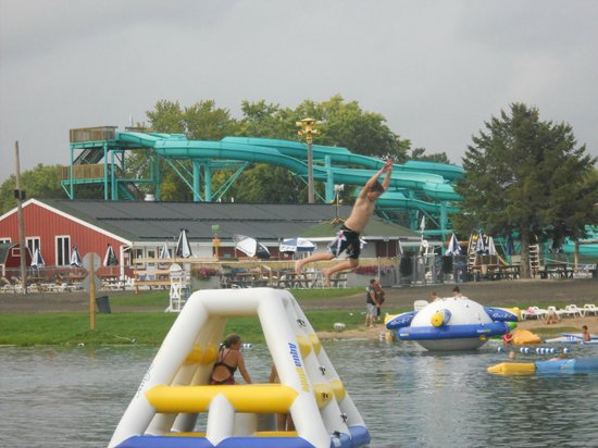River Bend RV Resort: Awesome swim pond with tons of inflatables, pool in background
