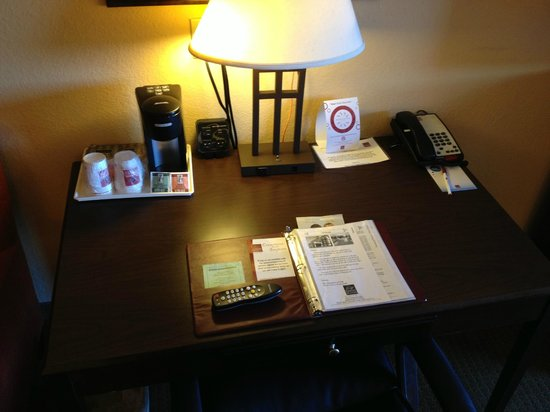 Comfort Suites Jacksonville I-295: Desk with orange Cat-5 cable behind the lamp.